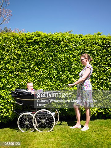 Mother pushing pram