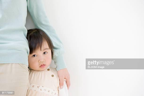 Mother putting hand on girl's shoulder