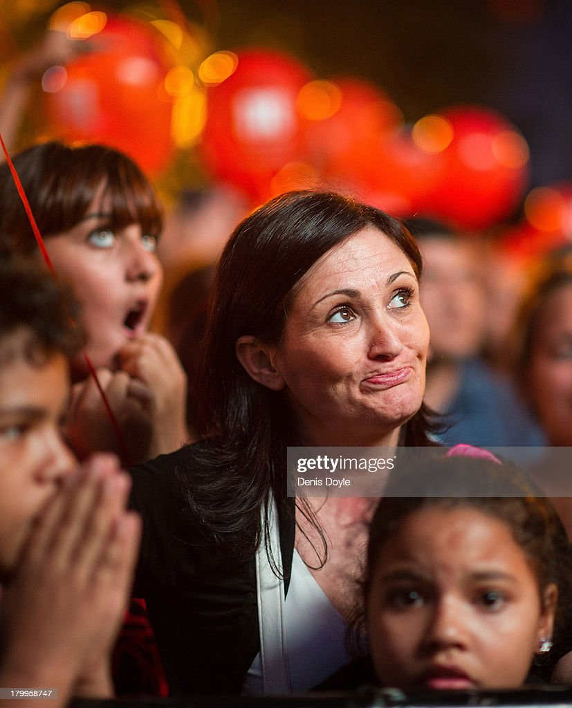 A mother reacts with her family after Madrid was eliminated from the 2020 Olympic Candidacy decision on September 7, 2013 in Madrid, Spain. The International Olympic Committee will choose between Tokyo, Madrid and Istanbul the host city for the 2020 Olympic Games at a meeting in Buenos Aires Seltember 7th.