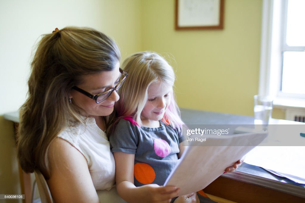 Mother reading with daughter : Stock Photo