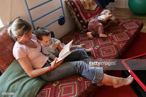 Annette Wassermann reads to her sons Damian and Leander 16 months at home after work May 9 2006 in Berlin Germany Wassermann and her husband Kostas...