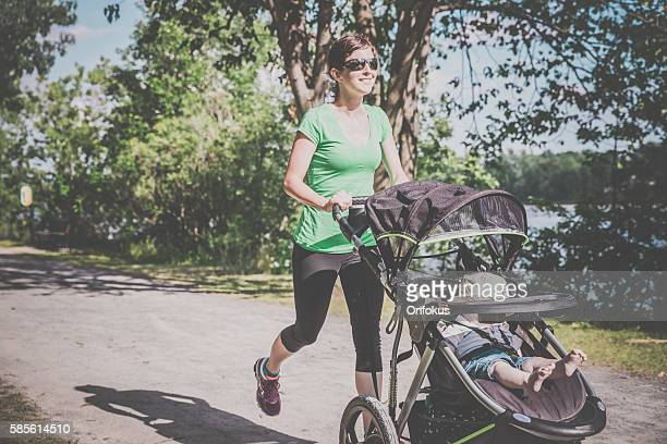 Mother Running Walking With baby Stroller in Park