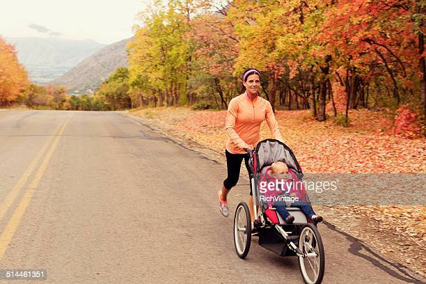 Mother Running with Daugter in Jogging Stroller