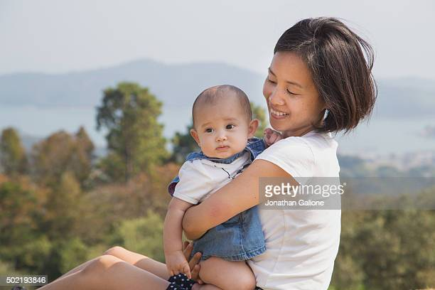 Mother sat holding her daughter
