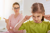 the education of the child. mother scolds her child girl. family relationships