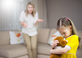 Mother scolds her young daughter. Family relationships.