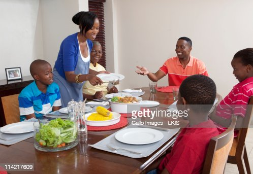 Mother Serving Food At Dining Room Table Johannesburg South Africa