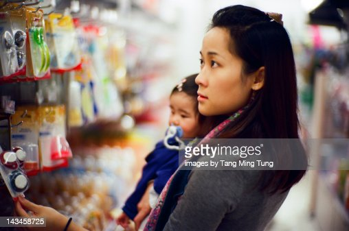Mother shopping for baby : Stock Photo