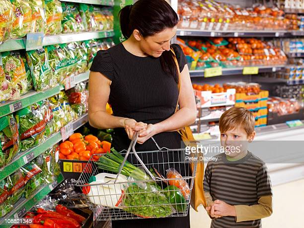 Mother shopping with son in supermarket