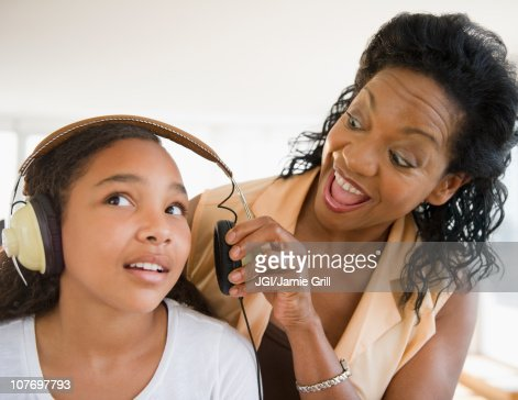Mother shouting at daughter listening to headphones