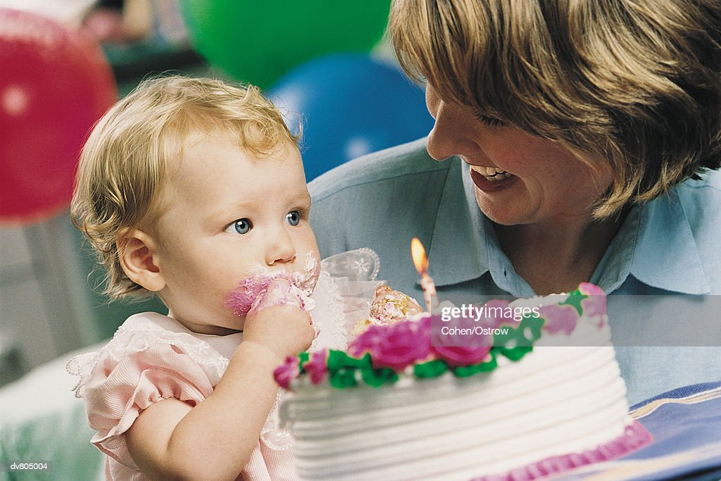 Mother Showing Her Baby a Birthday Cake