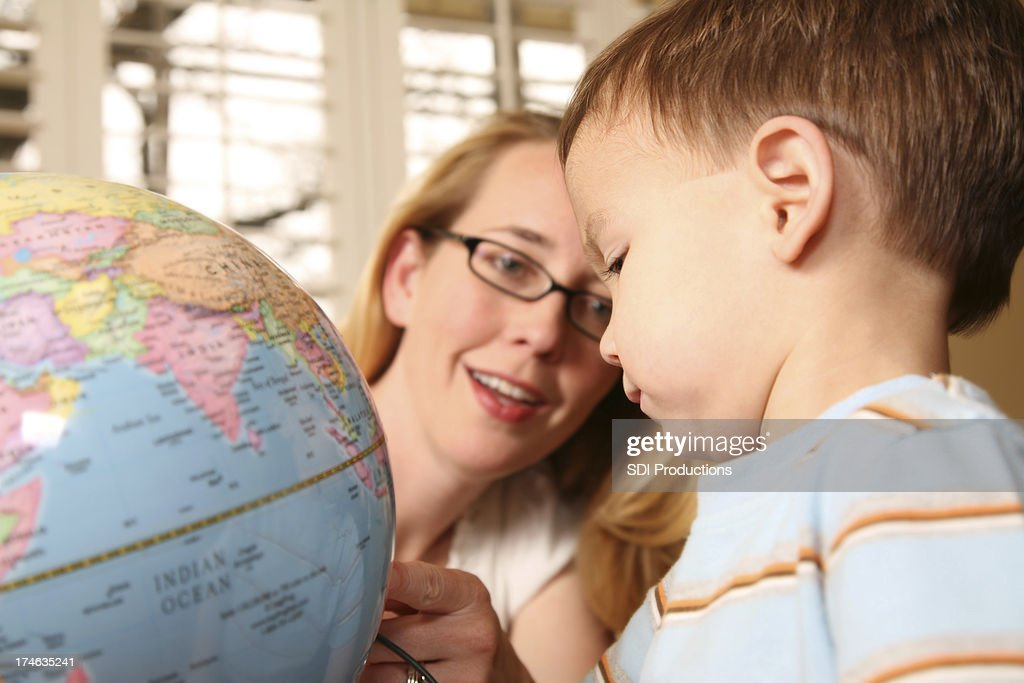 Mother Showing Toddler a Globe
