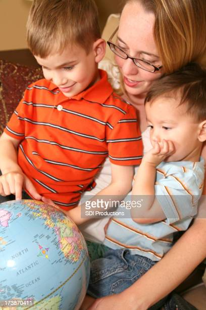 Mother Showing Two Sons a Globe