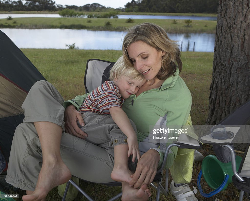 Mother sitting with son (2-4) on lap outside : Stock Photo