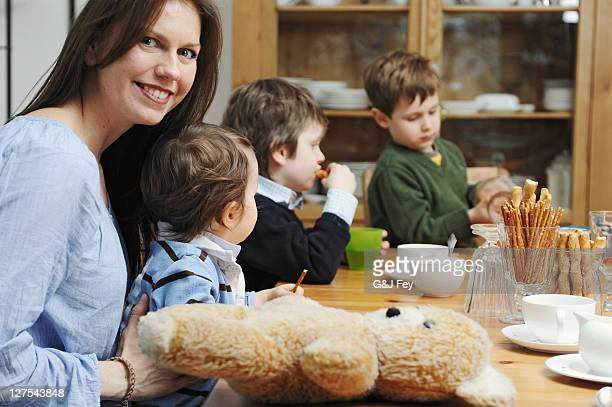 Mother sitting with sons at table