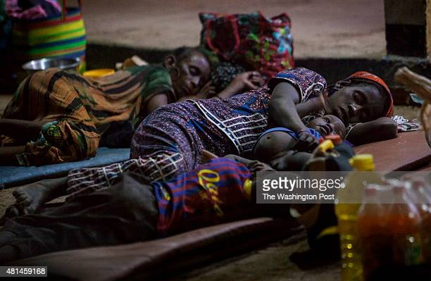 AGADEZ NIGER A mother sleeps on the ground of the Agadez bus station along her two sons Dozens of poor migrants regularly sleep on the streets as...