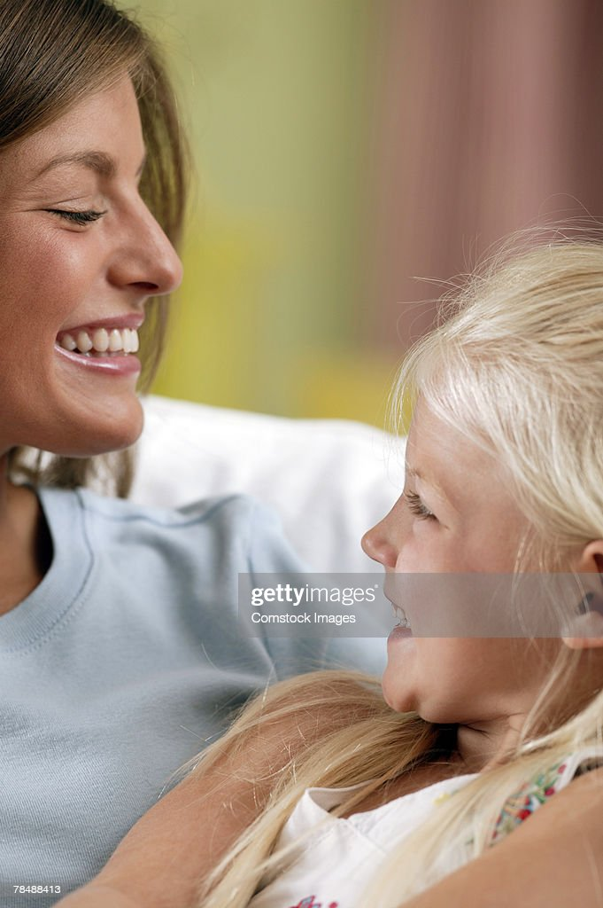 Mother smiling with daughter : Stock Photo