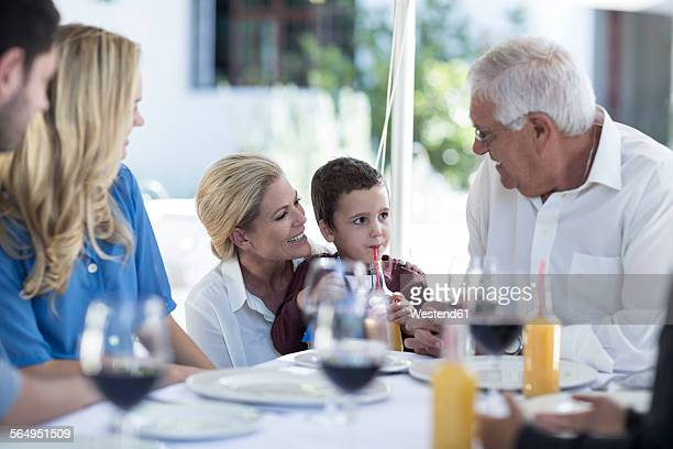 Mother, son and grandfather at family celebration