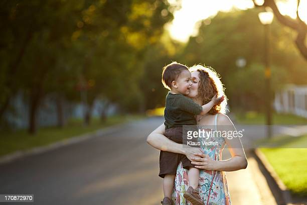 Mother & son hugging in the sunset