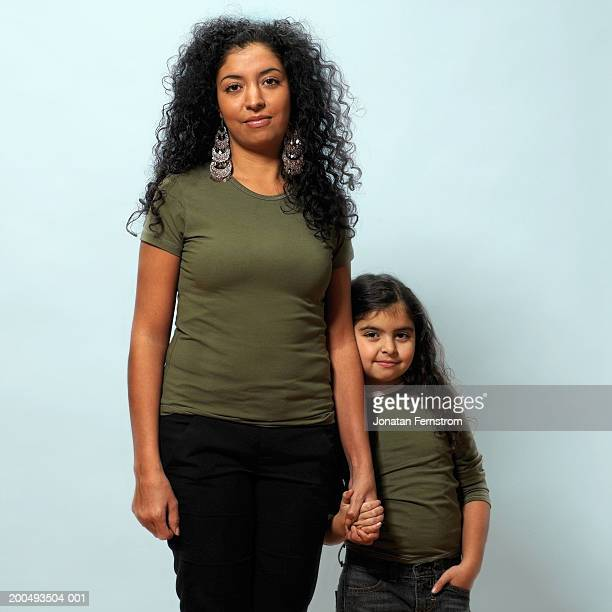 Mother standing with daughter, portrait