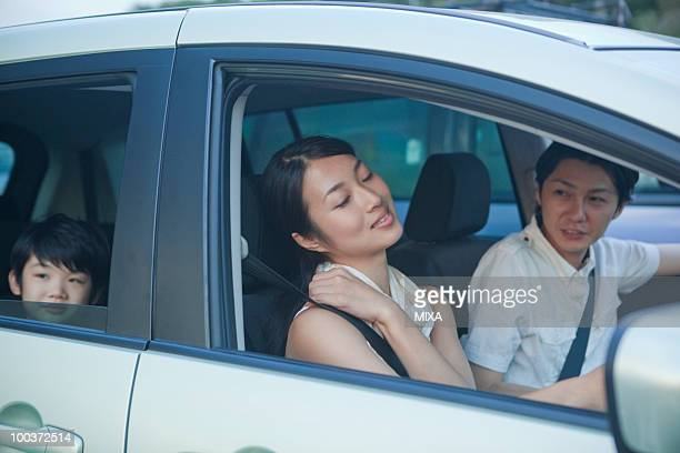 Mother Stretching at Driver's Seat
