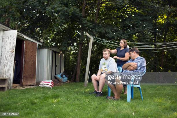 Mother Sue Landreth smoothes Ethan Poulin's hair during a weekly visit to his grandmother's house in Augusta Poulin has autism spectrum disorder and...