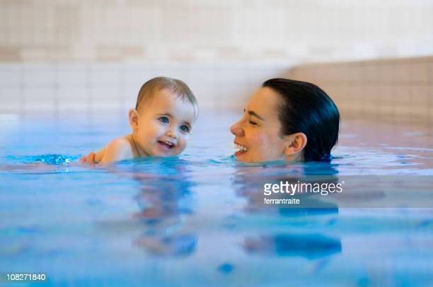 Mother Swimming with Baby Daughter in Pool