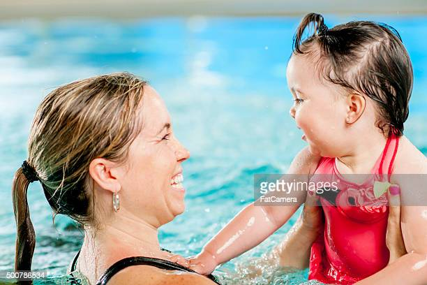Mother Swimming with Her Little Girl