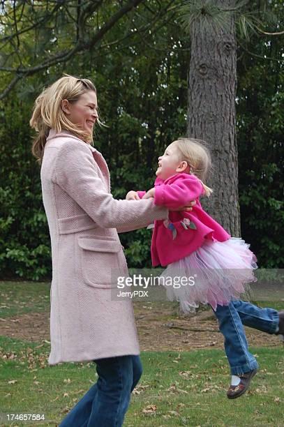 Mother Swings Daughter