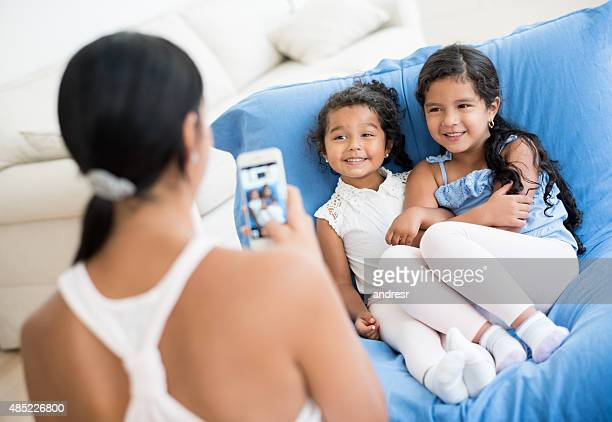 Mother taking a picture to her daughters
