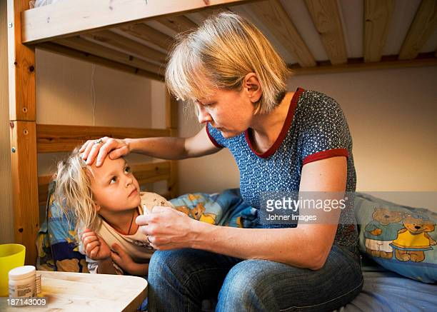 Mother taking care of sick daughter, Sweden.