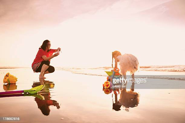 Mother taking picture of child by smartphone