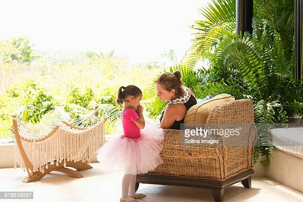 Mother talking to daughter in tutu
