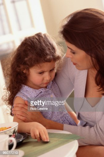 Mother talking to daughter : Stock Photo