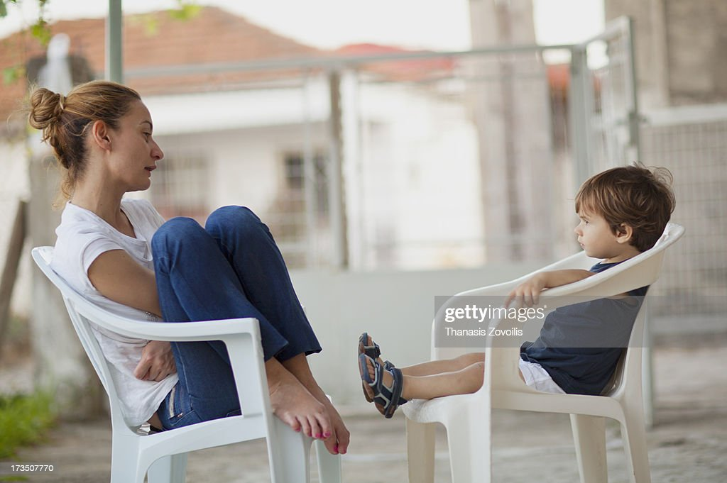 Mother talking to her kid : Stock Photo