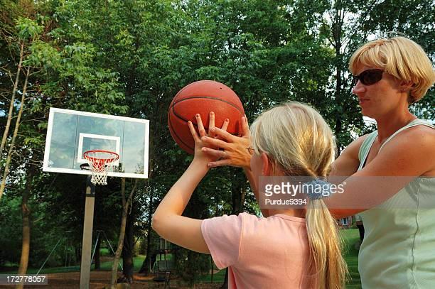 Mother Teaches Daughter Basketball