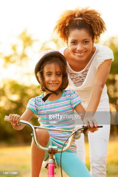 Mother Teaching Child to ride a bicycle