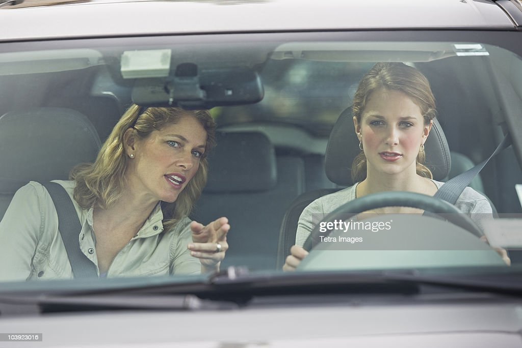 Mother teaching her daughter how to drive