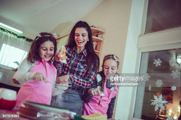 Mother Teaching Two Daughters How To Bake and Having Great Time