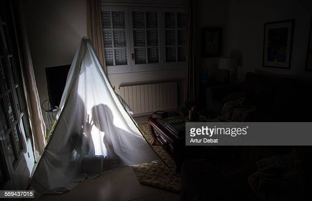 Mother telling a story to her son inside tent