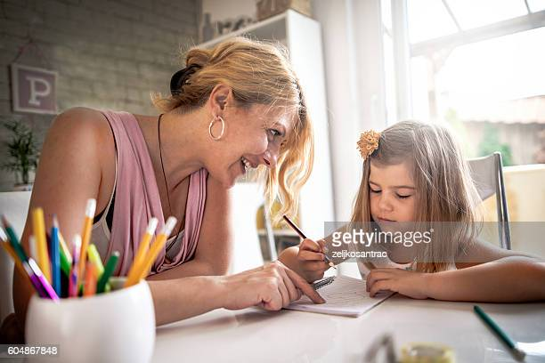 Mother Telling Off Daughter About Homework