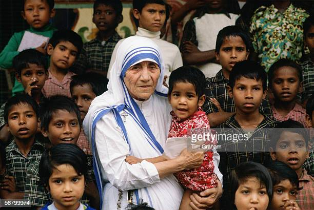 Mother Teresa accompanied by children at her mission in Calcutta India