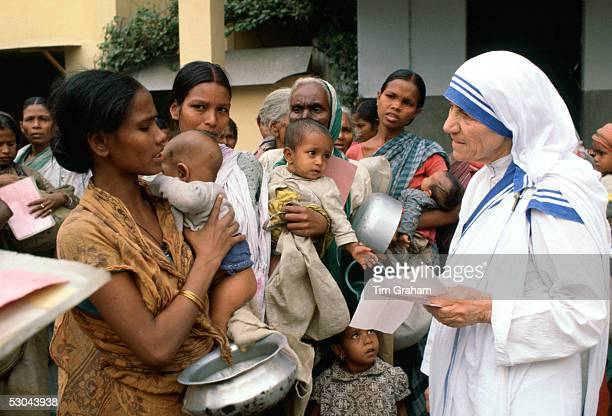 Mother Teresa with mothers and children at her Mission in Calcutta India