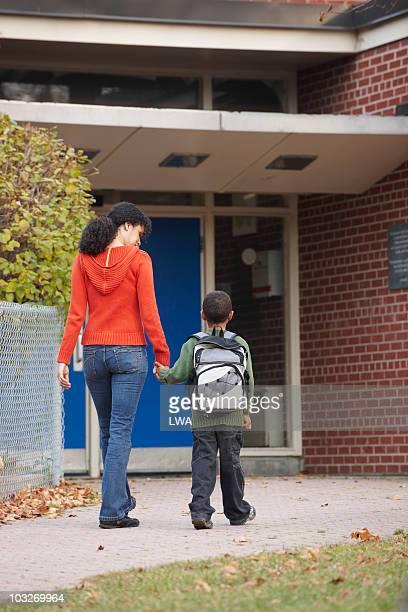 Mother Walking Son Into School