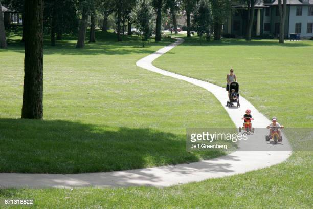 A mother walking with her children in Winona Lake Park