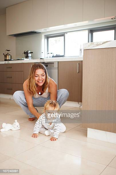 Mother watches as her child crawls