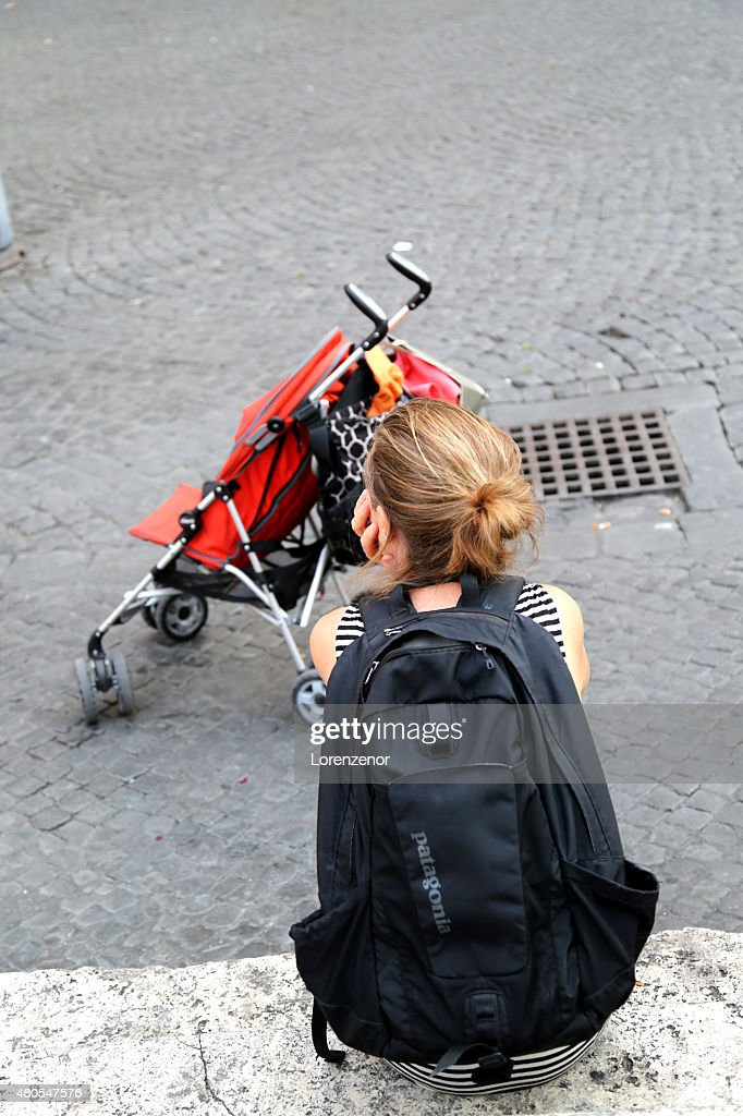 Mother watching her baby playing : Stock Photo