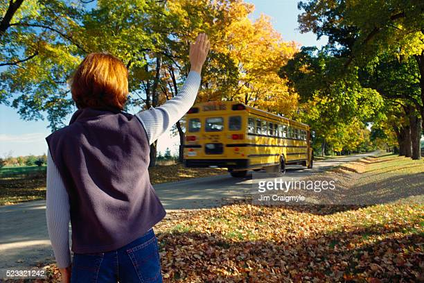Mother Waving at School Bus