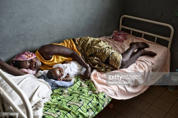 A mother who just gave birth to a child is seen recovering in her hospital bed during British Actor and UNICEF Ambassador James Nesbitt visits to the...