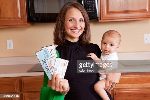 Mother With Baby And Coupons